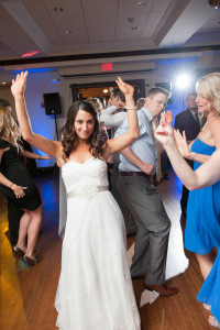 bride and guests having fun at wedding after enjoying planning wedding day