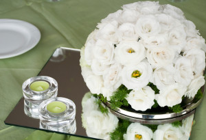 wedding table with estomas flowers arrangement and candles how to save money during wedding planning